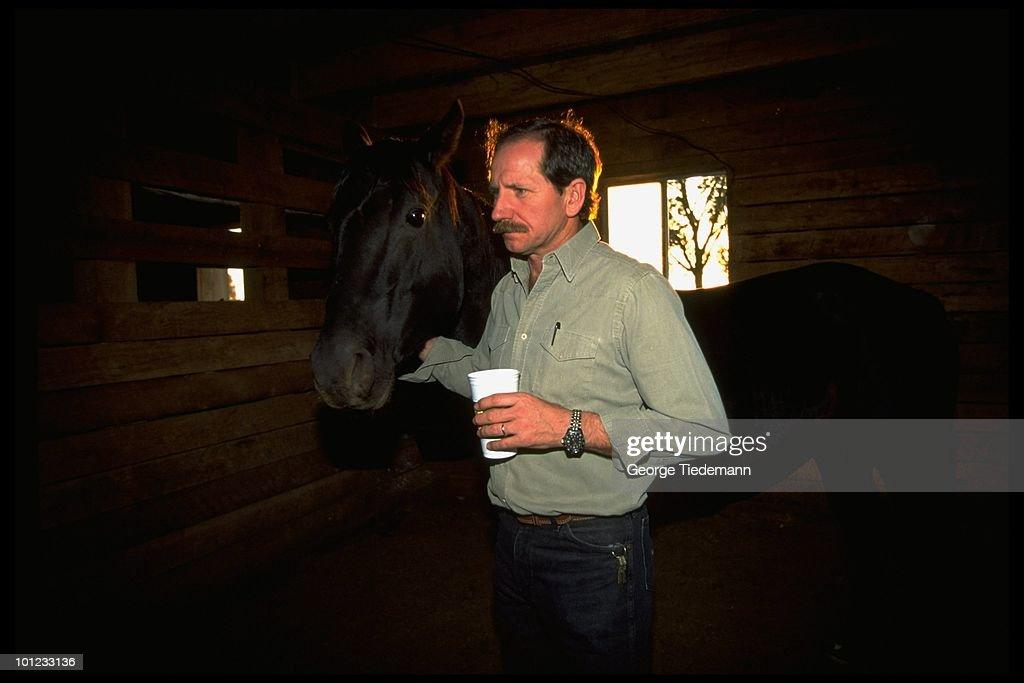 Portrait Dale Earnhardt with horses. Mooresville, NC