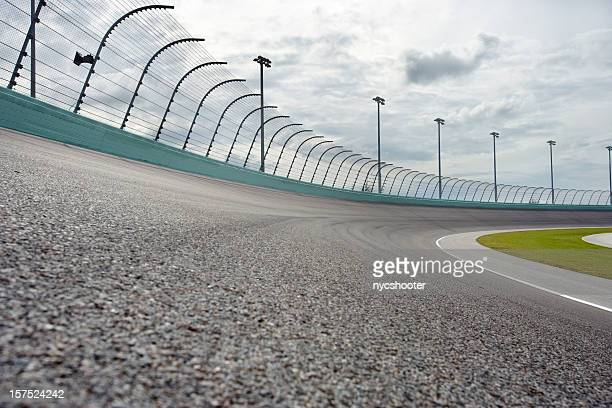 auto racing racetrack turn - motor racing track stock pictures, royalty-free photos & images