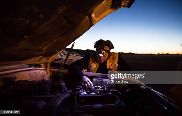 Rallye Aicha des Gazelles Virginie Duedal of Team 127 checks under the hood of her car before starting leg of race Over 300 women from around the...