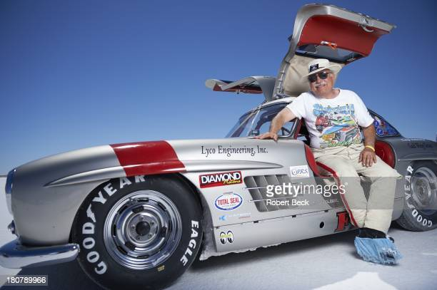 Speed Week Portrait of land speed racer Bob Sirna of Rochester MI posing in front of his 1955 Gullwing Mercedes with a top speed of 179 mph during...