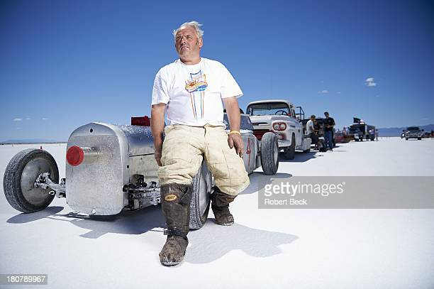Speed Week Portrait of land speed racer Shug Hanchard of Scotland via Yucaipa CA posing with his Blown Gas modified roadster Model A with top speed...