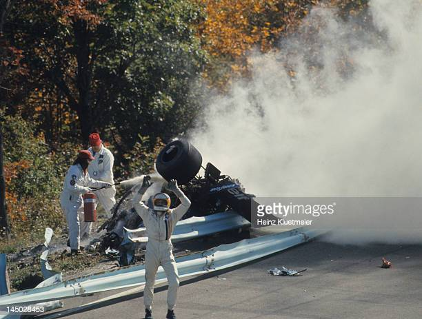 US Grand Prix Qualifying Overall view of guardrail collision that killed Francois Cevert as Jody Scheckter motioning to call for help during Saturday...
