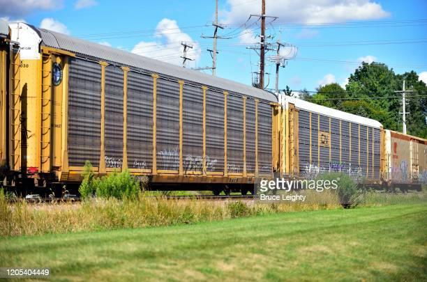 auto rack freight train - geneva illinois stock pictures, royalty-free photos & images