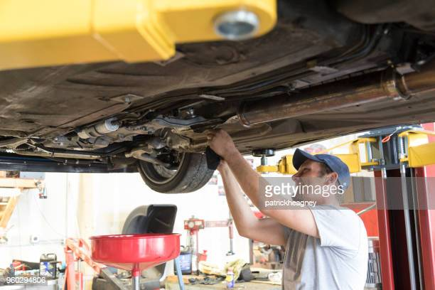 auto repair garage with mechanic - oil change stock pictures, royalty-free photos & images