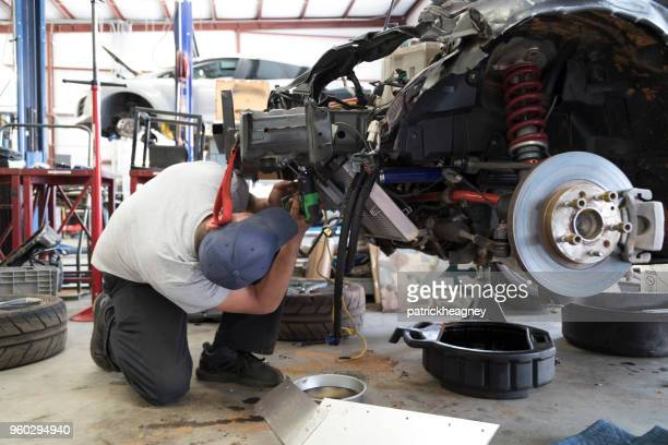 auto repair garage with mechanic - dismantling stock pictures, royalty-free photos & images