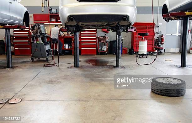 Auto Repair Shop Interior with Mechanic in Background