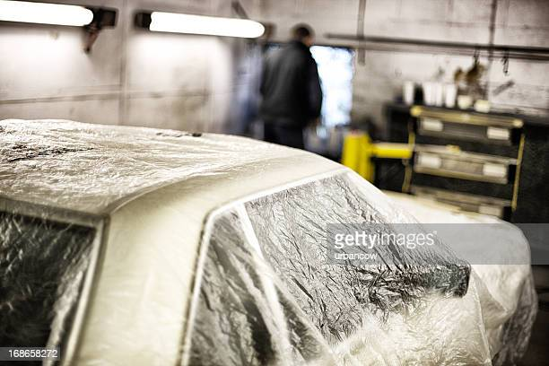 auto repair shop, plastic dust sheeting - man wrapped in plastic stock pictures, royalty-free photos & images