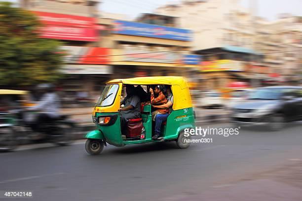 auto rickshaw - a popular transport medium in indian cities - rickshaw stock photos and pictures