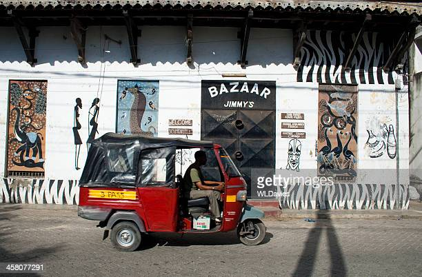 auto rickshaw against street murals - mombasa stock photos and pictures