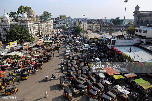 Auto rickshaws and other vehicles sit in traffic in the Charminar area of Hyderabad, India, on Tuesday, March 11, 2014. Indias bulls are putting...