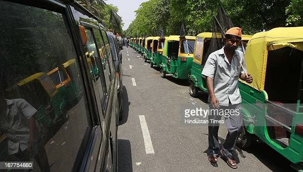 Auto Rickshaws and Taxis remain off the road demanding increase in the fare prices during the Auto Rickshaw and Taxi Adhikar Rally at Rajghat on...