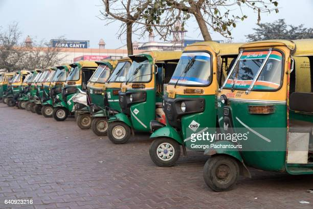 auto rickshaws in india - rickshaw stock pictures, royalty-free photos & images