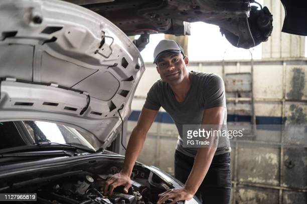 auto service latin afro worker / owner - brazilian ethnicity stock pictures, royalty-free photos & images