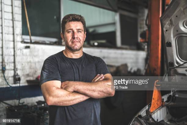auto service worker/owner - waist up stock pictures, royalty-free photos & images