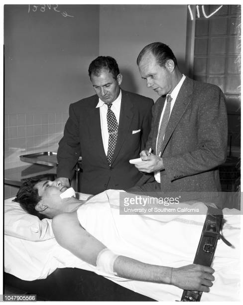 Auto theft suspect shot by officer 2 March 1958 Marcos Badillo 22 years Jack Perry 23 years Officer MA PozzoOfficer LW LaneCaption slip reads...