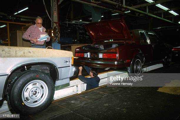 Auto workers at a General Motors Assembly plant are photographed January 12 1982 in Tarrytown New York