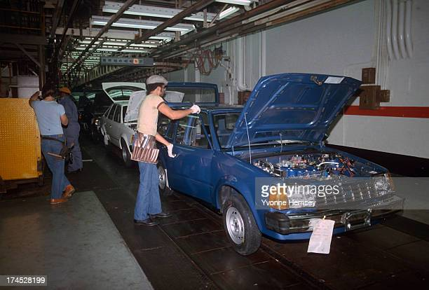 Auto workers at the Ford assembly plant in Edison New Jersey are photographed January 14 1982
