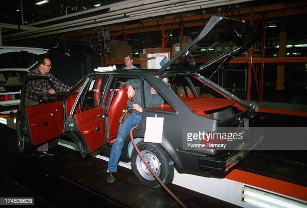 Auto workers at the Ford plant in Edison New Jersey are photographed January 14 1982
