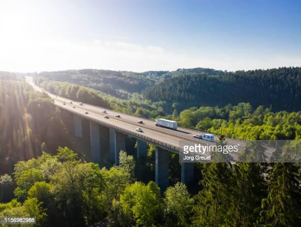 autobahn bridge - lkw stock-fotos und bilder