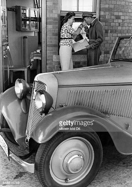 Autobahn near Fuerstenwalde: man and woman at a gas station with a small lounge and restaurant - - Photographer: Herbert Hoffmann - Published by:...