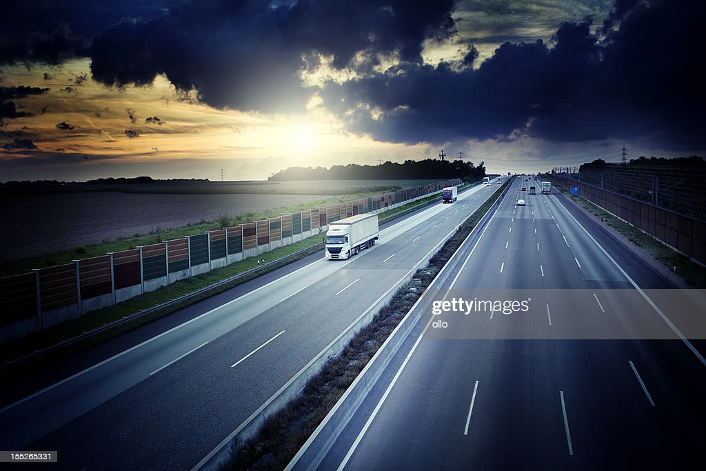 Autobahn - view from a bridge at dusk, dramatic sky : Stock Photo