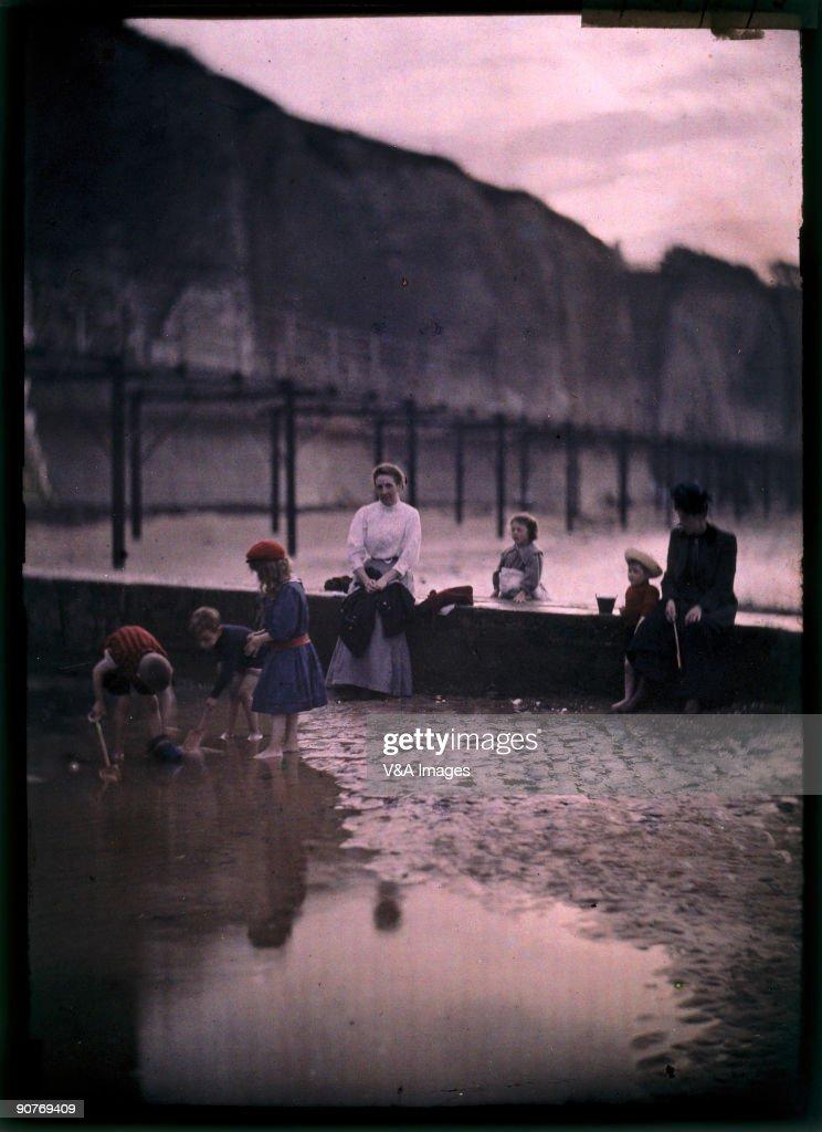 Children by the breakwater, c.1908. : News Photo