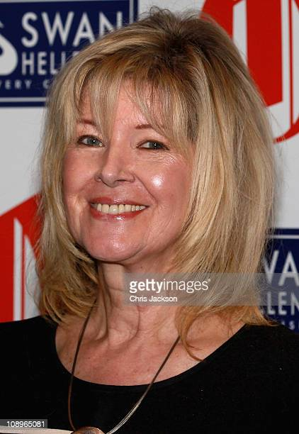 Autocutie of the Year Julia Somerville poses for photographs as she attends the 'Oldie of the Year Awards 2011' at Simpsons on February 10 2011 in...