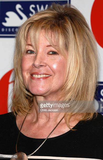 Autocutie of the Year Julia Somerville poses for photographs as she attends the 'Oldie of the Year Awards 2011' at Simpsons on February 10, 2011 in...