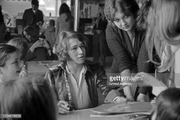 """Autograph session with singer Peter Maffay at """"Burger Chef"""" convenience restaurant, Germany, 1960s."""