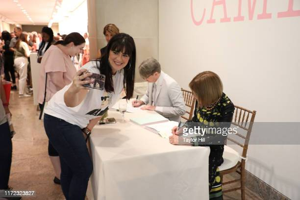 """Autographs copies of the """"Camp: Notes on Fashion"""" exhibition catalogue at Metropolitan Museum of Art on September 04, 2019 in New York City."""
