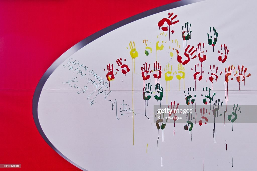 Autographs of Bollywood movie actress Kajol and CEO MD of Unilever India Nitin Paranjpe adorn a wall alongside children`s handprints at a Global...