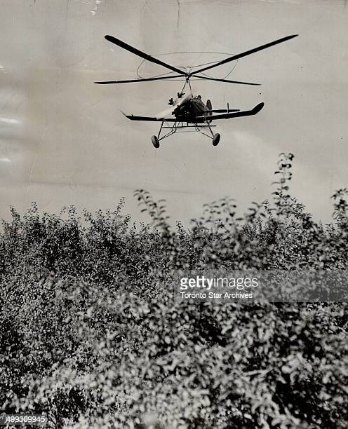 Autogyro hovers over orchard to spray trees Harvest time is here but people growers want the fruit to stay on the trees to develop a rosier glow and...