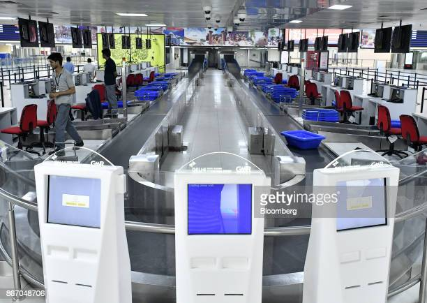 Automated checkin machines stand next to manned checkin desks inside the newly inaugurated Terminal 2 building at the Indira Gandhi International...