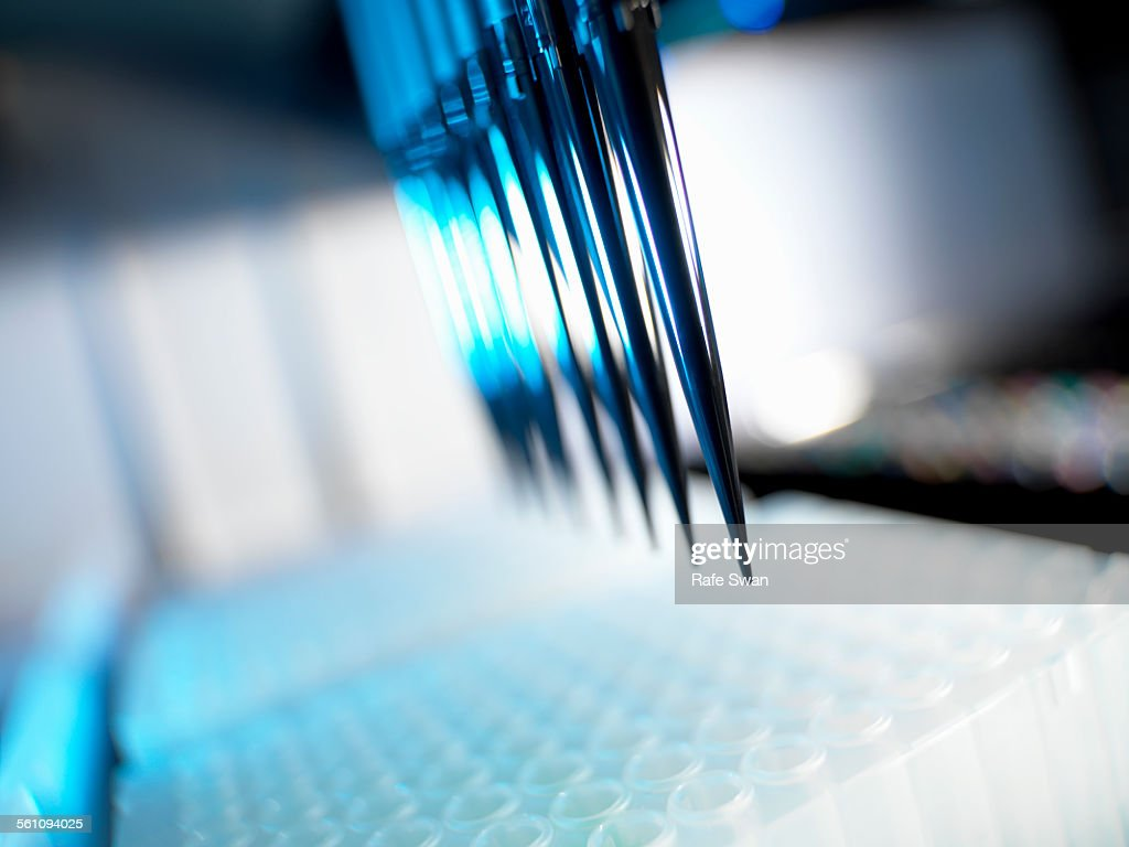 Automated chemical sampler in action used to test chemical and dna samples : Stock Photo