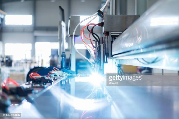 automated drill machine drills on steel sheet - strike industrial action stock pictures, royalty-free photos & images