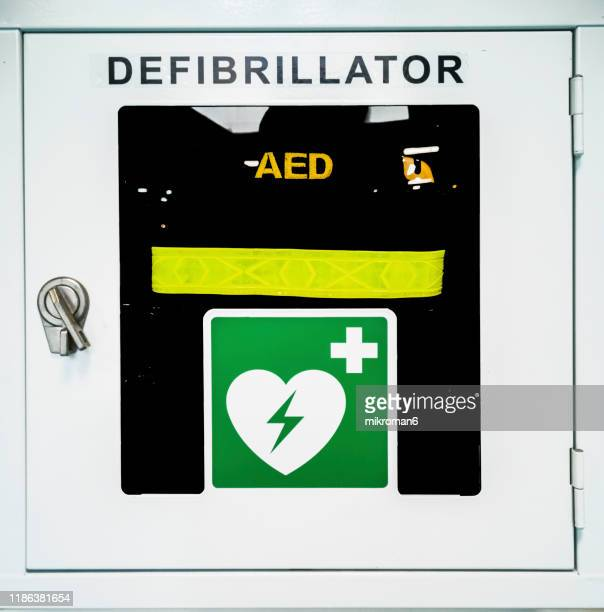 aed automated external defibrillator in public area - cardiac arrhythmia stock pictures, royalty-free photos & images