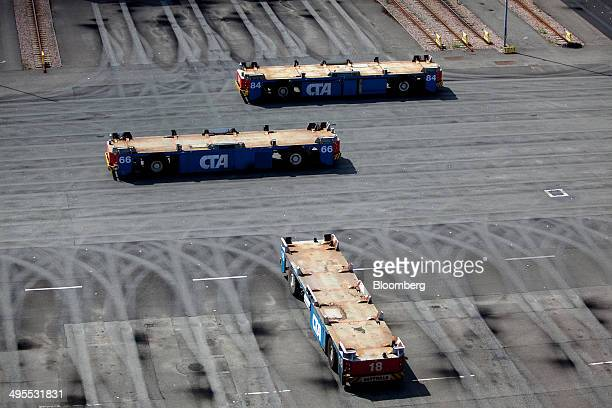 Automated guided vehicles for handling shipping containers stand on the dockside at the HHLA Hamburg Container Terminal Altenwerder in the Port of...