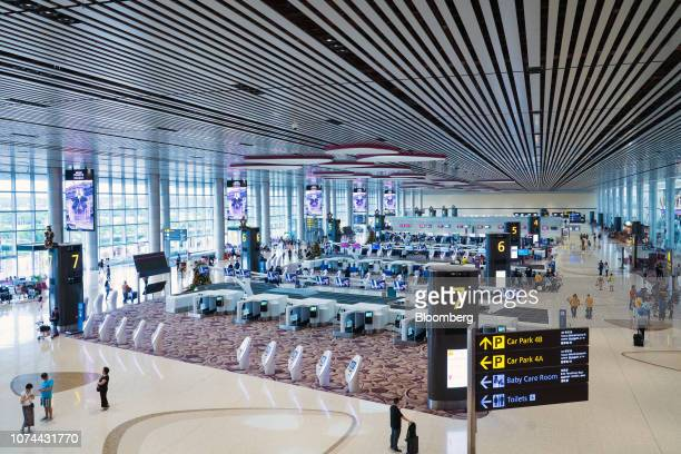 Automated luggage dropoff machines stand in the departure hall at Terminal 4 of Changi Airport in Singapore on Thursday Dec 13 2018...