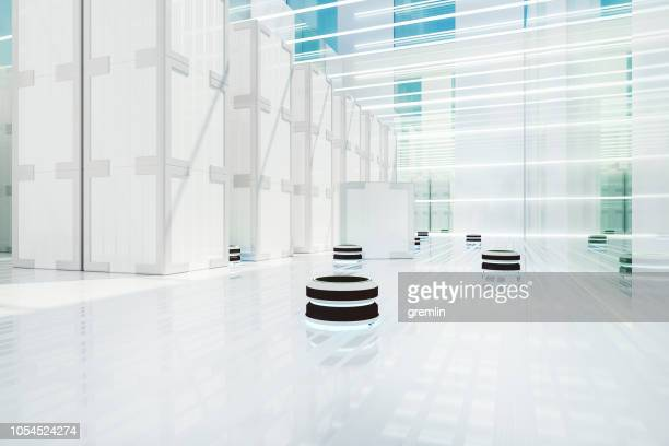 automated robot carriers in futuristic distribution warehouse - autonomous technology stock pictures, royalty-free photos & images