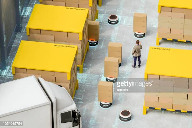 automated robot carriers in modern distribution warehouse - autonomous technology stock pictures, royalty-free photos & images