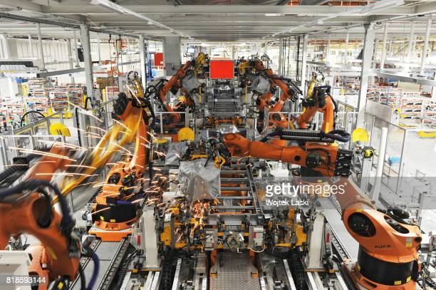 Automated robotic arms assemble parts of a Volkswagen Crafter van in the newly opened Volkswagen AG manufacturing plant in Bialezyce near Wrzesnia...