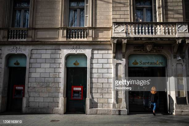 Automated teller machines sits outside a Banco Santander SA bank branch in Barcelona Spain on Friday March 6 2020 Spanish bank shares soared after...