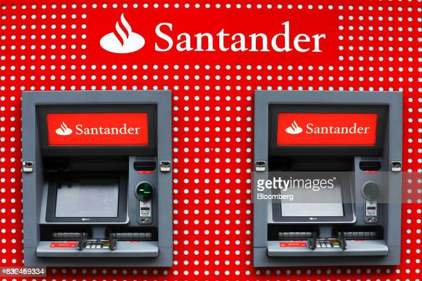Automated teller machines stand outside a bank branch of Banco Santander SA in London UK on Tuesday Aug 15 2017 Banco Santander Spains biggest lender...