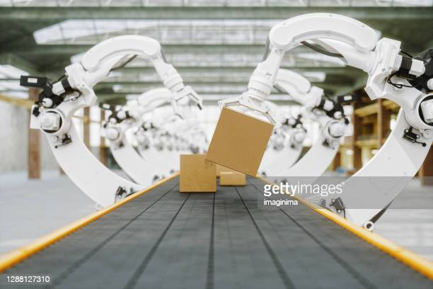 automated warehouse with robotic arms - cardboard box stock pictures, royalty-free photos & images