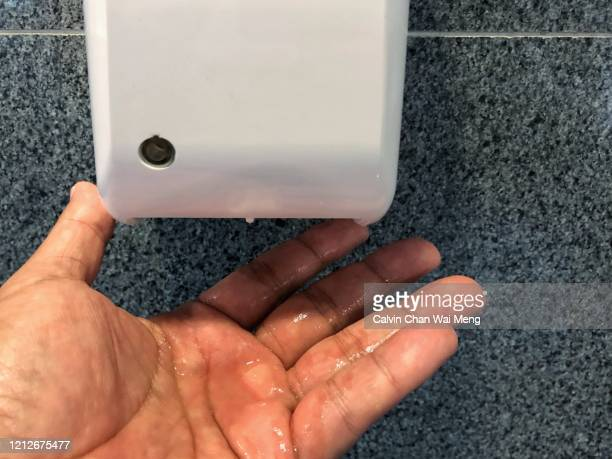 automatic hand sanitizer dispenser - rubbing alcohol stock pictures, royalty-free photos & images