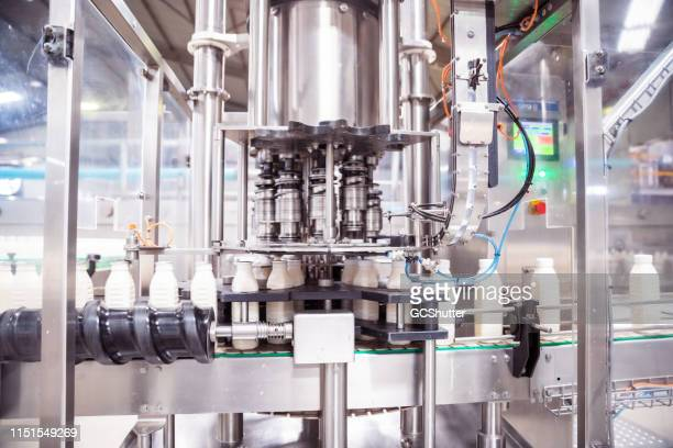 automatic milk bottling factory in africa - food and drink industry stock pictures, royalty-free photos & images