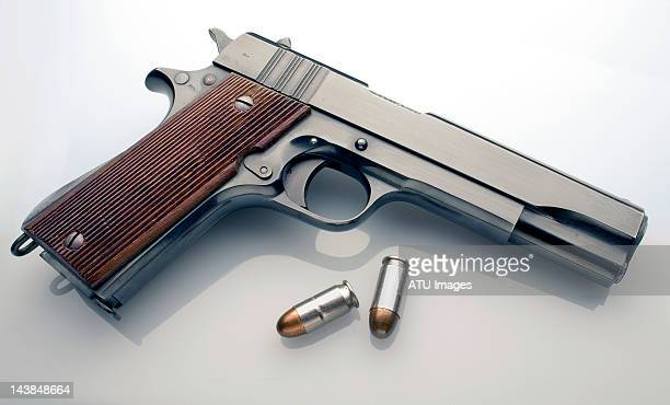 45 automatic pistol profile with bullets