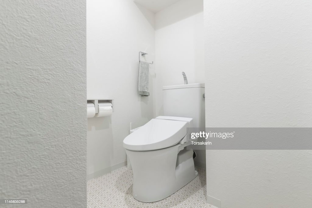 Automatic toilet in the modern toilet : Stock Photo