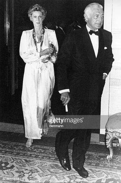 FIAT automobile company president Gianni Agnelli and his rarely photographed wife MarellaCaracciolo attend a dinner in honor of Britain's Queen...