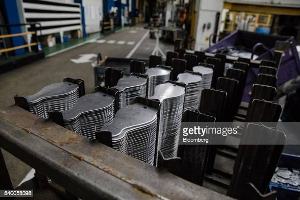 Automobile components sit stacked in the GMS auto parts factory in La Souterraine La Creuse region France on Monday July 24 2017 Even as President...